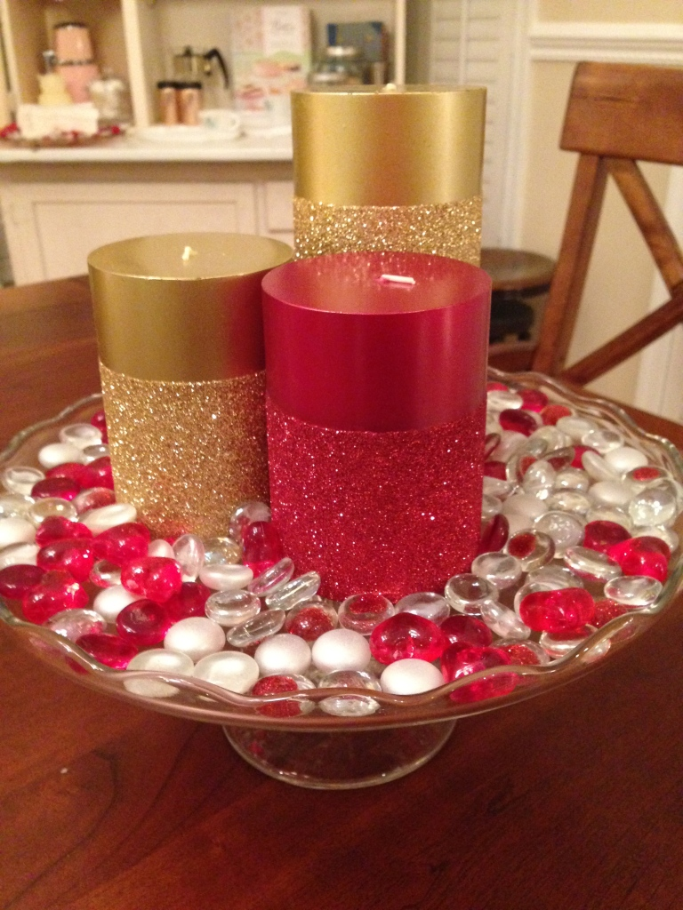 I used a cake stand for the centerpiece of my dining room table.  The glass beads and the candles are from Pier 1 Imports.