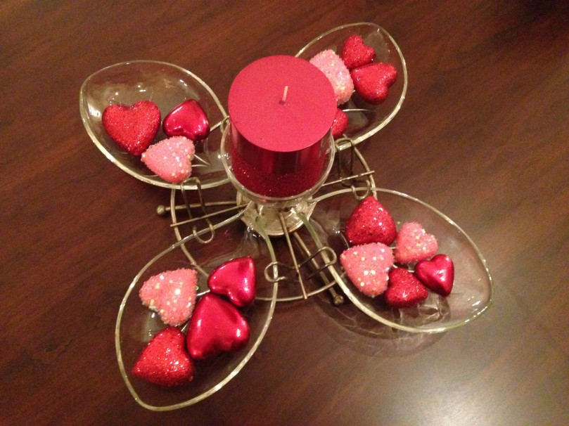 This is an old retro server that I turned into a centerpiece for my coffee table.  I bought the hearts and candle at Pier 1 Imports.  I thought outside the box and bought the candle at 75% off because they were in the Christmas clearance section.  The candle ended up being about $2.50.